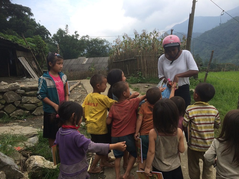 Sapa hand out pens to children